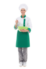 young woman in chef uniform mixing something in green plastic bo