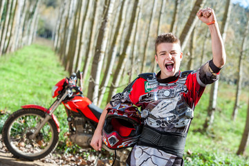 Motocross champion with winning attitude.