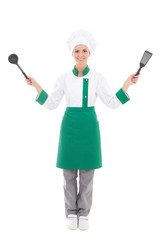 woman in chef uniform with kitchen tools - full length isolated