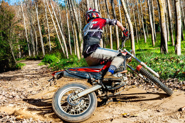 Motocross rider doing spin.