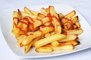 Frenchg fries and ketchup © Arena Photo UK