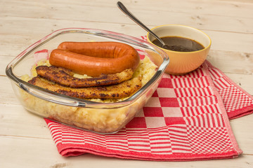Typical dutch dish zuurkool with pork belly and smoked sausage