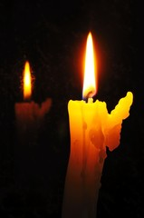 Bent white candle with reflection © Arena Photo UK