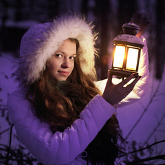 beautiful girl on winter forest
