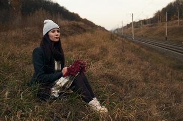 woman sitting near railway