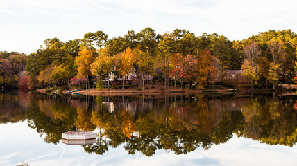 House and Trees on Lake in Autumn