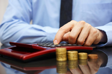 businessman calculating growing income,
