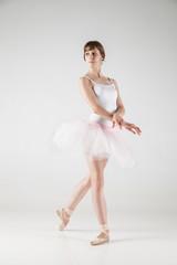 Ballet dancer in white tutu posing