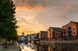 Fototapety Redeveloped Warehouses along the River in Leeds at Sunset