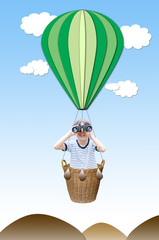 Little boy with binoculas in the hot air balloon Basket on white