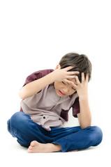 Little boy with headache on white background