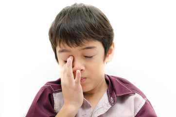 Little boy pain his eyes put finger in on white backgroud