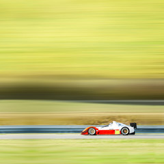 formula one race car on speed track - motion blur background