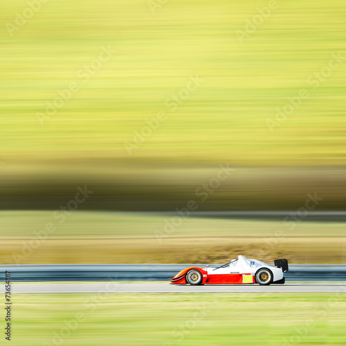 Fotobehang Formule 1 formula one race car on speed track - motion blur background