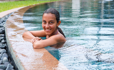 Pretty Asian Indian Woman on the Pool