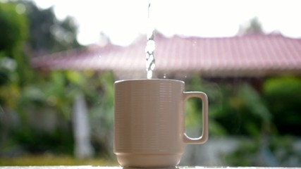 Boiling Water for Delicious Cup of Tea or Coffee. Slow Motion.