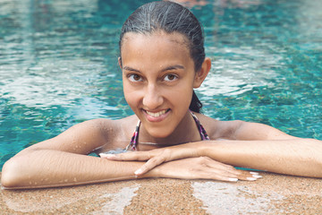 Portrait of a smiling attractive woman in a pool