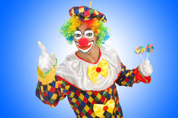 Clown with lollipops isolated on white