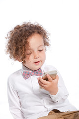 Adorable Curly Young Kid Looking at Mobile Phone