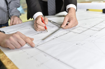 Closeup on construction plan set on table