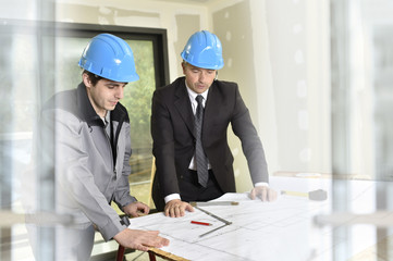 Engineer on building site with construction worker