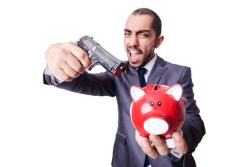 Businessman killing the piggy bank