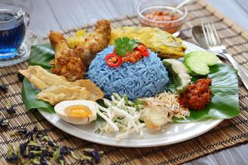 nasi kerabu, blue color rice salad, malaysian cuisine