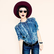 Glamorous fashion lady in a stylish jeans clothes. Country style