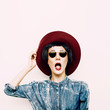 Vintage funny lady in a stylish denim shirt and hat. hipster sty