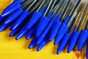 Blue pens with caps © Arena Photo UK