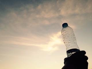 a bottle of water in hands