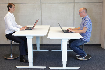 coworkers in correct sitting posture on  leaning seats