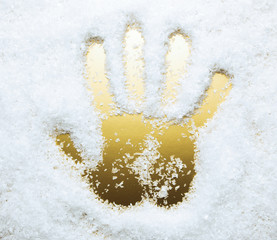 Hand print in artificial snow, golden color