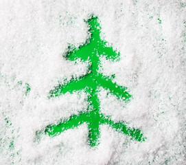 Christmas tree shape on snow background