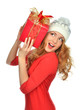 woman hold red Christmas wrapped gift present smiling