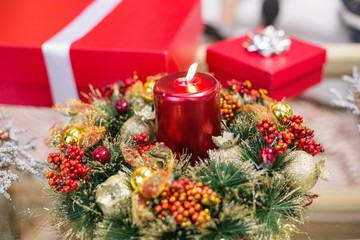 Candle and wreath on table for christmas