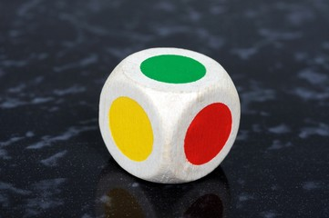 Standard six sided die with coloured spots