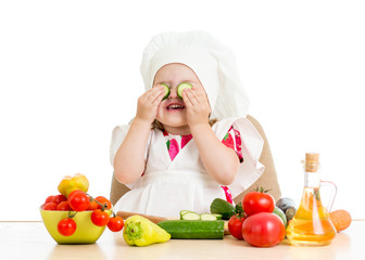 beautiful little girl with food vegetables