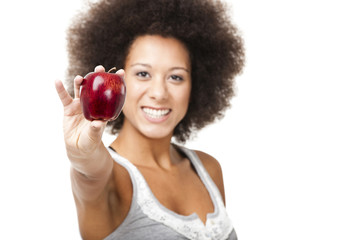 African American  young woman holding and showing a red apple