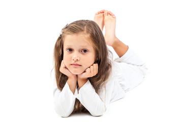 Little cute girl lying head leaning on hands.