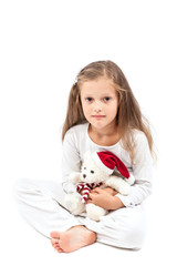 Little cute girl with Christmas bear in hands.