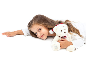 Little cute girl with a soft toy bear in hands.