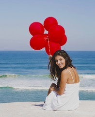 Girl with red balloons