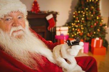 Father christmas holding engagement ring with his box