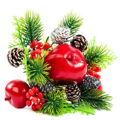 Christmas decoration, fir branch, pine cones, cranberry, apple.