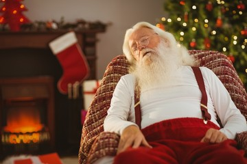 Santa claus napping on the armchair