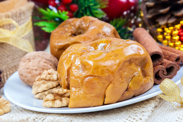 Baked apples with nuts and cinnamon on a background the Christma
