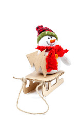 Snowman on a sled with Christmas tree on a white background.