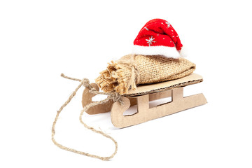 Sleigh with a sack and a Santa Claus hat.