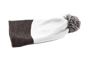 Knitted woollen hat on white background.